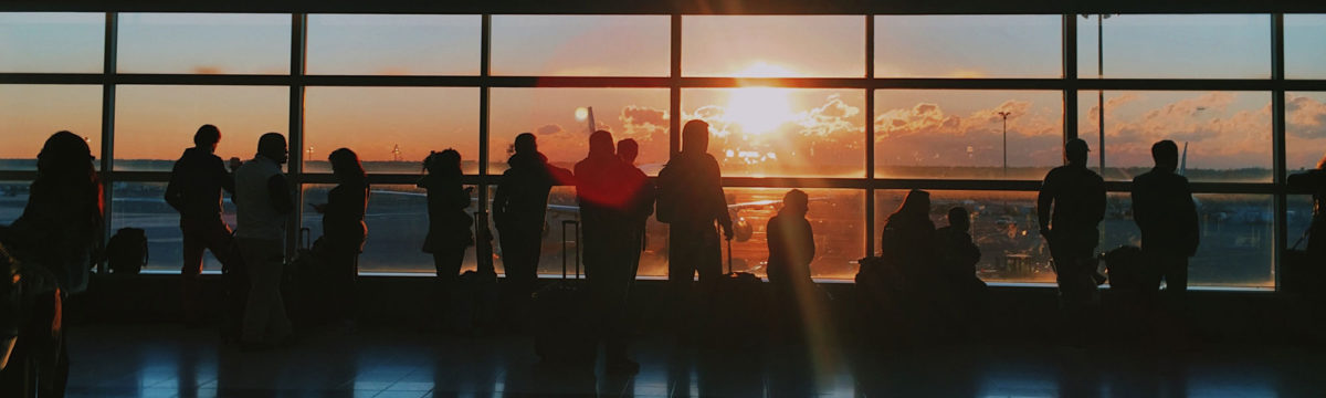 People at airport Photo by Jon Tyson on Unsplash