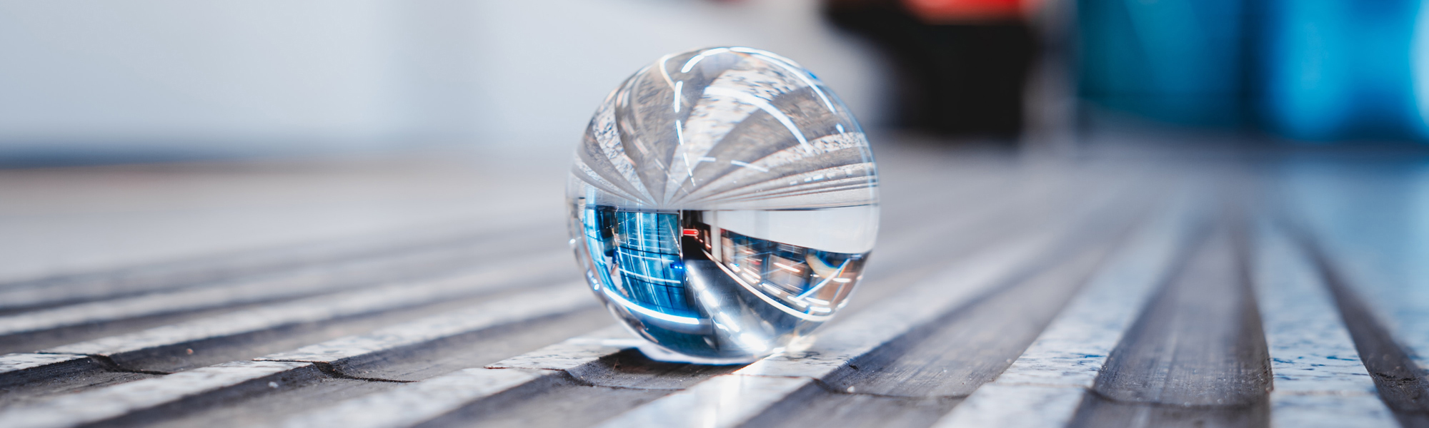 Crystal ball in a subway station. Photo by Rico Reutimann on Unsplash