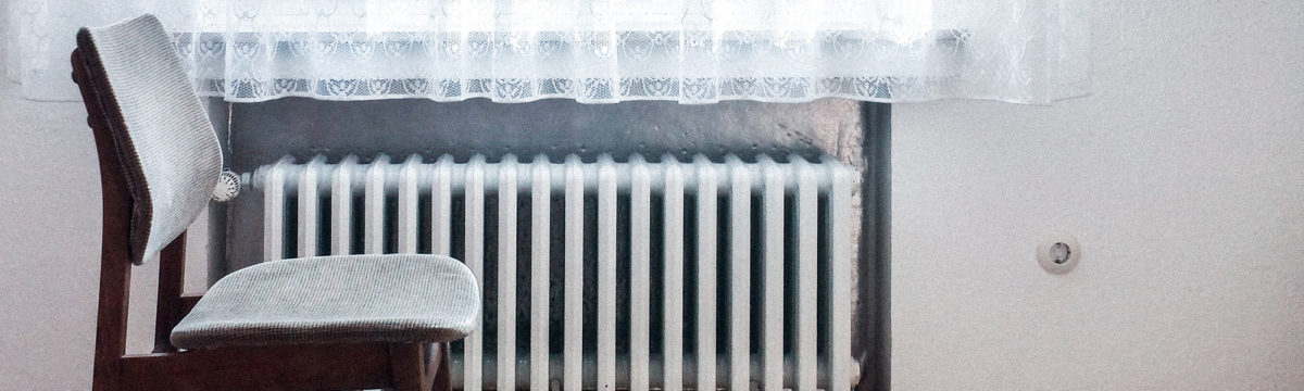 Old fashioned radiator. Photo by Dominik Kuhn on Unsplash