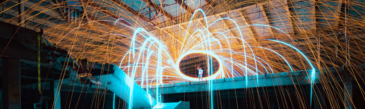 Factory with sparks Photo by Sean Pierce on Unsplash