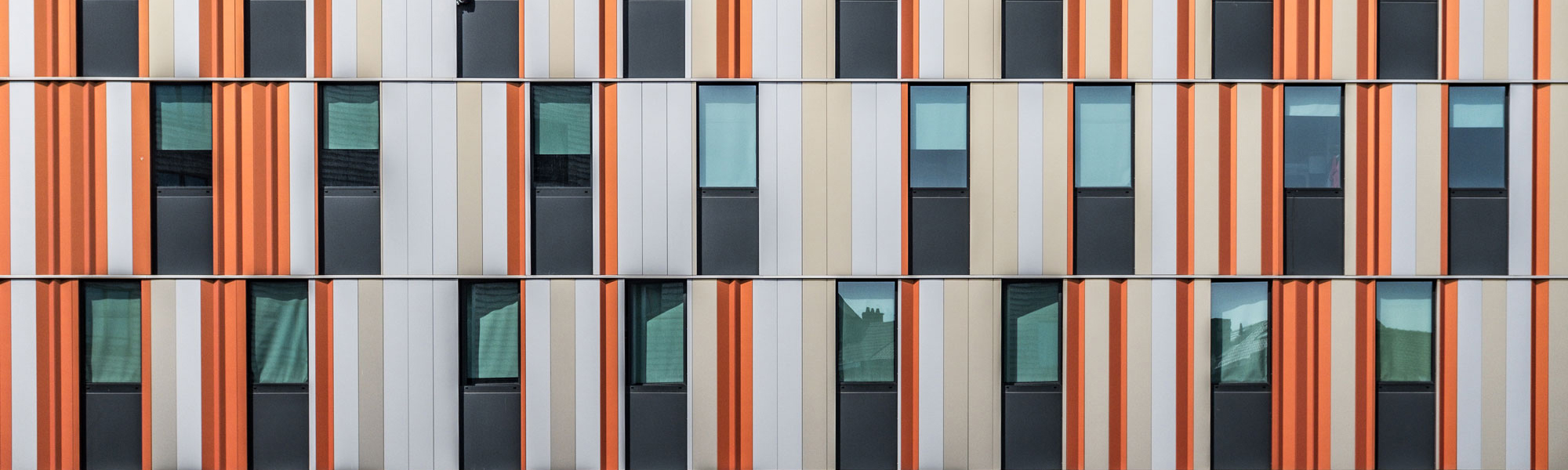 Orange window shuttters Photo by Bernard Hermant on Unsplash