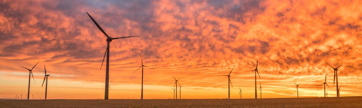 Sunset behind wind turbines. Photo by Karsten Würth (@karsten.wuerth) on Unsplash