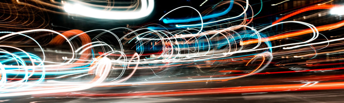 Traffic in motion at night Photo by Osman Rana on Unsplash