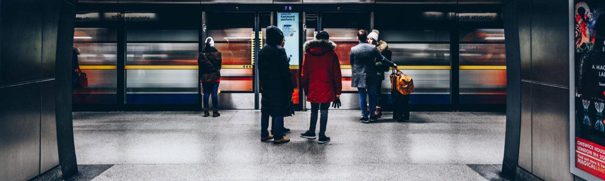 Passengers on London tube Photo byChristopher BurnsonUnsplash